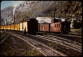 Coaches on excursion train.  Freight cars and caboose #0585 on another train - Durango.<br /> D&amp;RGW  Durango, CO