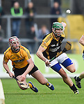 Cillian Fennessy of Clonlara in action against Cathal Doohan of Ballyea during their senior county final replay at Cusack Park. Photograph by John Kelly.