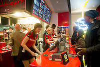"Hundreds of burger lovers descend on the new Steak 'n Shake Signature restaurant in New York on its grand opening day, Thursday, January 12, 2012. The popular midwest chain opened its first New York outpost with a new concept for the restaurant, a smaller footprint and counter-only service, hence their ""Signature"" branding. Founded in 1934 the company has nearly 500 restaurants with this one in New York being next to the Ed Sullivan Theatre where the Late Show with David Letterman Show is taped. © Frances M. Roberts)"