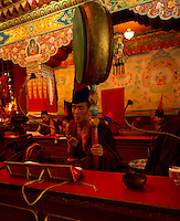 Buddhist monk with a drum during the Losar chanting in a monastery in Sikkim India