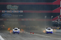 Jun. 19, 2011; Bristol, TN, USA: NHRA funny car driver Jack Beckman (left) races alongside Melanie Troxel during eliminations at the Thunder Valley Nationals at Bristol Dragway. Mandatory Credit: Mark J. Rebilas-