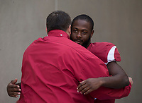Hawgs Illustrated/BEN GOFF <br /> Bret Bielema, Arkansas head coach, hugs free safety De'Andre Coley during recognition of senior players before the game against Missouri Friday, Nov. 24, 2017, at Reynolds Razorback Stadium in Fayetteville.