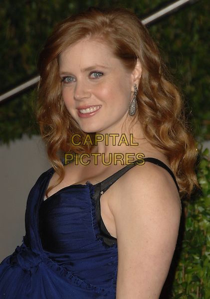 AMY ADAMS.The 2010 Vanity Fair Oscar Party held at The Sunset Tower Hotel in West Hollywood, California, USA..March 7th, 2010.headshot portrait blue half length oscars.CAP/RKE/DVS.©DVS/RockinExposures/Capital Pictures.