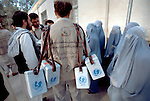 Health workers come to pick up the polio vaccine and coolers at the Herat General Hospital in the morning of the national immunization days in Herat, Afghanistan, on April 16, 2002.(photo by Jean-Marc Giboux)