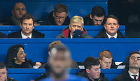 Arsenal Manager Arsene Wenger watches the match from above the dugouts during the Carabao Cup semi final 1st leg match between Chelsea and Arsenal at Stamford Bridge, London, England on 10 January 2018. Photo by Andy Rowland.