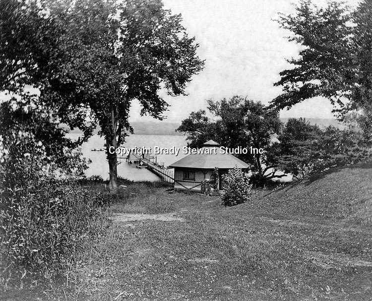 Lakewood NY:  The boat house behind the Boarding house where the Stewart's stayed during their trip to Lakewood/Lake Chautauqua - 1901. Photographs taken during a church field trip to Chautauqua Institution in New York (Lake Chautauqua). The Stewart family and friends visited Chautauqua during 1901 to hear Stewart relative, Dr. S.H. Clark  speak at the institute. Alice Brady Stewart chaperoned and Brady Stewart came along to photograph the trip.  The Gallery provides a glimpse of how the privileged and church faithful spent summers at Lake Chautauqua at the turn of the century.