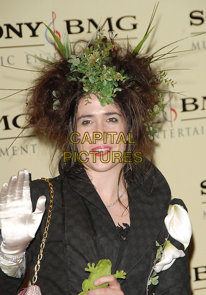IMOGEN HEAP.attends The Sony / BMG Post Grammy Party held at The Beverly Hills Hotel in Beverly Hills, California, USA, February 11 2007..half length fashion disaster green feather leaves grass in hair clip accessory black puffy skirt dress hand glove waving.CAP/DVS.©Debbie VanStory/Capital Pictures