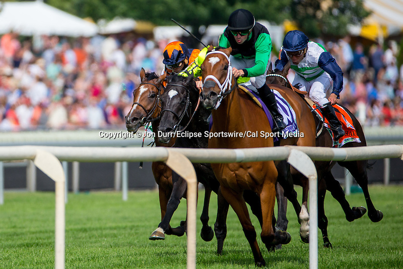 AUG 16, 2014:  The Pizza Man (right), ridden by Florent Geroux, and Dandino (left), ridden by Lanfranco Dettori, lead the field in the final stretch of the third running of the American St. Leger at Arlington International Race Track in Arlington Heights, IL. Jon Durr/ESW/Cal Sport Media