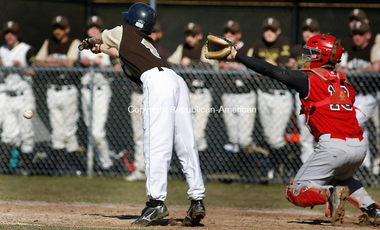 Winsted, CT-01 April 2007-041907MK05  Thomaston's #4 Kyle Capaldo lays down a bunt in front of Northwestern's # 18 Dan Bittel during action in the Thursday afternoon baseball game at Northwestern Regional High School.  Northwestern held the lead for much of the game but had to make up two runs in the bottom of the seventh to win 9-7..  The  Michael Kabelka Republican / American.(Thomaston's #4 Kyle Capaldo lays down a bunt in front of Northwestern's # 18 Dan Bittel) CQ