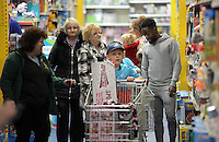 Pictured: Nathan Dyer joins children shopping Wednesday 08 December 2016<br />Re: Swansea City FC players have bought Christmas gifts for 60 children at Smyths toy store in Swansea, south Wales.