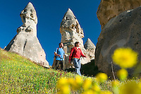 Cappadocia, Nevsehir, Turkey, May 2010. Two hikers, walk from the Village of Goreme to Uchisar through Pigeon Valley. The fairy landscape of Goreme National Park is unique in its kind. Millions of years long, wind and water sculpted the tuffstone into spectacular rock formations.  Photo by Frits Meyst / MeystPhoto.com