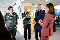 19/03/2020 - Picture released by Kensington Palace of Prince William Duke of Cambridge and Kate Duchess of Cambridge talking with Chief Executive of the London Ambulance Service, Garrett Emmerson, and an unidentified staff member (left) during a visit to the London Ambulance Service 111 control room in Croydon on Thursday to meet ambulance staff and 111 call handlers who have been taking NHS 111 calls from the public, and thank them for the vital work they are doing. Photo Credit: ALPR/AdMedia