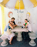 BERMUDA, Hamilton, portrait of friends sitting in Rock Island Coffee Cafe