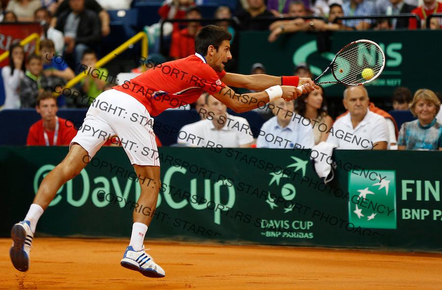 Tennis Tenis<br /> Davis Cup semifinal polufinale<br /> Serbia v Canada<br /> Novak Djokovic v Vasek Pospisil<br /> Novak Djokovic returns the ball<br /> Beograd, 13.09.2013.<br /> foto: Srdjan Stevanovic/Starsportphoto &copy;