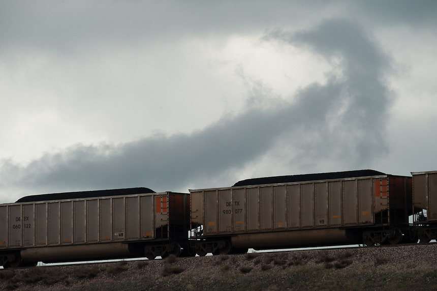 A loaded coal train moves out from the Spring Creek Mine, a Cloud Peak Energy property in southern Montana, Friday, May 17, 2013. Pending new ports for shipment to Asia through either the U.S. or Canada, Cloud Peak Energey hopes to open new high-grade coal mines on and near the Crow Reservation in southern Montana. The tribe is equally hopeful the new mines would bring long-awaited economic stability to the tribe. (Kevin Moloney for the New York Times)