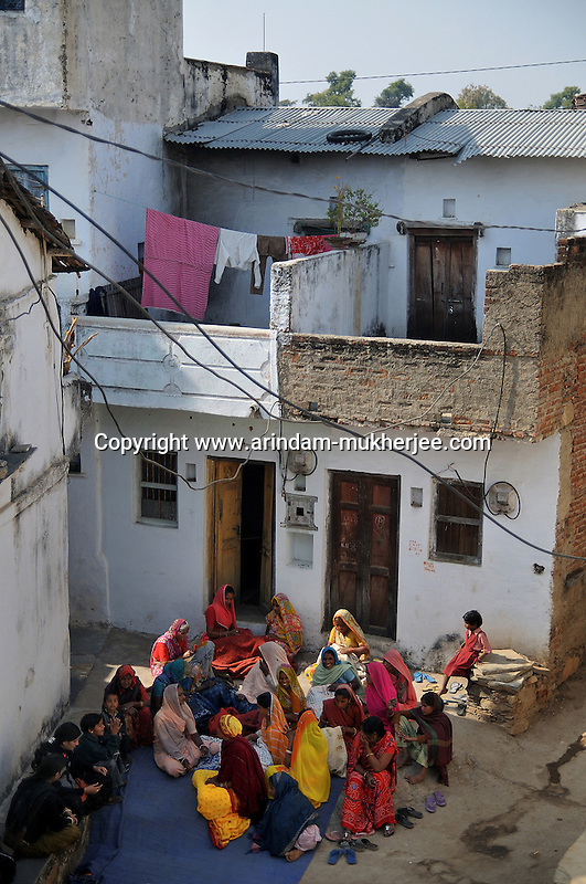 Women of Seeshvi village doing their embroidery assignment in front of the centre of Sadhna Udaipur,  Rajasthan, India. 25.1. 2011. Arindam Mukherjee.