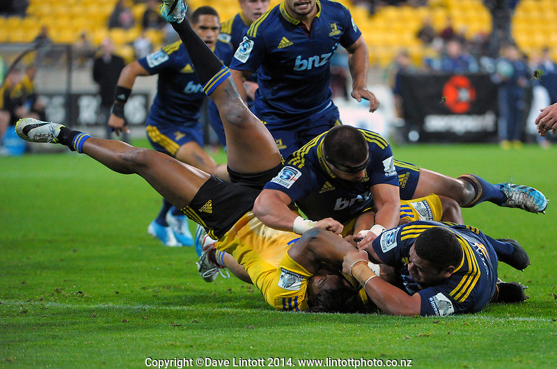 Julian Savea prevents a try during the Super Rugby match between the Hurricanes and Highlanders at Westpac Stadium, Wellington, New Zealand on Friday, 16 May 2014. Photo: Dave Lintott / lintottphoto.co.nz