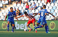Getafe's Mehdi Lacen (l) and Almeria's Angel Trujillo (c) during La Liga match.August 23,2013. (ALTERPHOTOS/Victor Blanco)