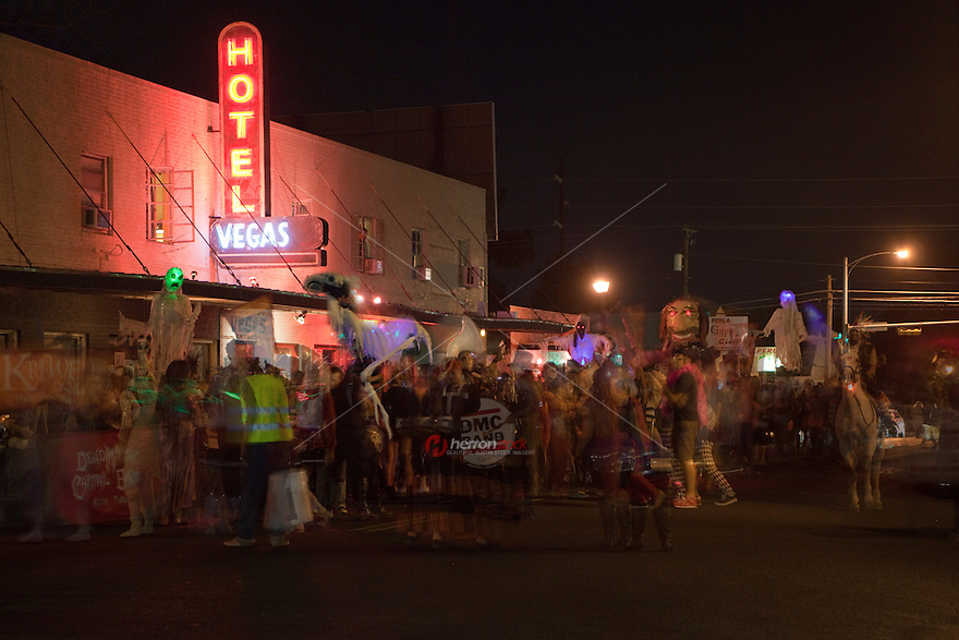 Zombie marching band parades through the East Austin bar district on Halloween