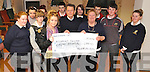 CHEQUE THIS: Rockmount Day Care Centre, Kilgarvan, was presented with a cheque for €278, proceeds from a disco run by the Kilgarvan Youth Club on Thursday last. Pictured are Karen O'Shea, Mike Murphy (chairman of Centre), Bridie Dillon, Linda Twomey, Saoirse Fennessy, Jack Hegarty, Leighann Horgan, Charlotte Fallarton, Sean Tiffin, Sean Godfrey and Aoife Godfrey.