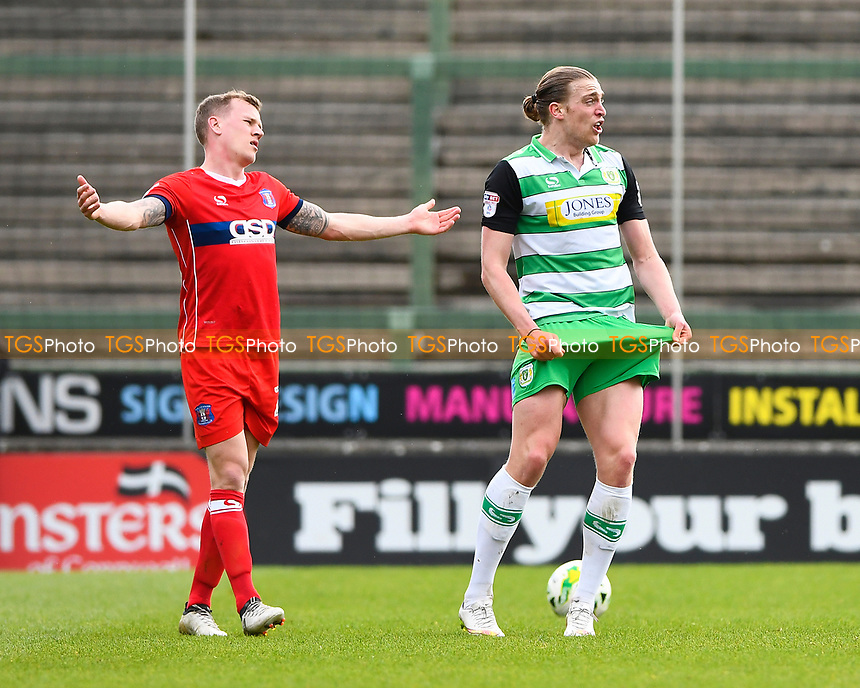 Tom Eaves of Yeovil Town appeals for having his shorts pulled as Tom Miller of Carlisle United left pleads his innocence during Yeovil Town vs Carlisle United, Sky Bet EFL League 2 Football at Huish Park on 1st April 2017