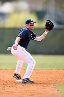 February 22, 2009:  Second baseman Pierre LePage (9) of the University of Connecticut during the Big East-Big Ten Challenge at Naimoli Complex in St. Petersburg, FL.  Photo by:  Mike Janes/Four Seam Images