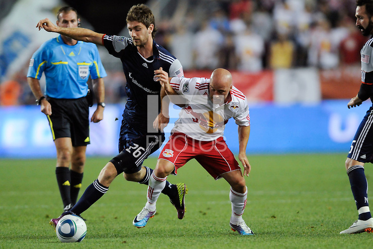 Stephen McCarthy (26) of the New England Revolution and Luke Rodgers (9) of the New York Red Bulls battle for the ball during a Major League Soccer (MLS) match at Red Bull Arena in Harrison, NJ, on June 10, 2011.