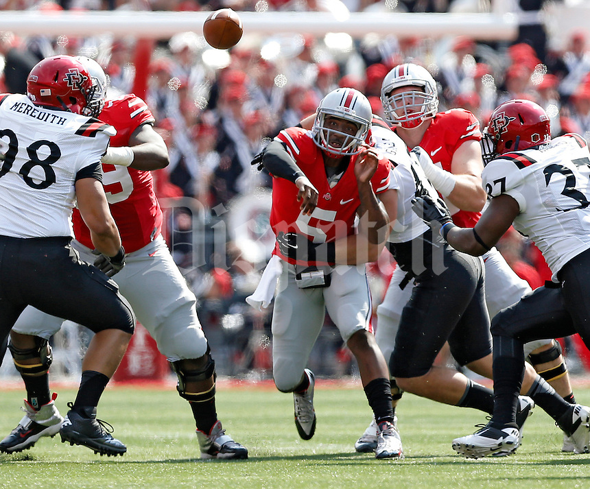 Ohio State Buckeyes quarterback Braxton Miller (5) gets off a pass against San Diego State Aztecs linebacker Jake Fely (42) during the 1st quarter of their college football game at Ohio Stadium in Columbus on September 7, 2013.  (Dispatch photo by Kyle Robertson)