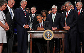 "United States President Barack Obama (C) signs the the financial reform bill into law during a ceremony with (L-R) Robin Fox, Andrew Giordano, U.S. Vice President Joe Biden, U.S. Senate Majority Leader Harry Reid (D-NV), U.S. Representative Maxine Waters (D-CA), U.S. Senate Banking Committee Chairman Christopher Dodd (D-CT), U.S. House Financial Services Committee Chairman Barney Frank (D-MA) and U.S. House Majority Leader Steny Hoyer (D-MD) at the Ronald Reagan Building and International Trade Center, Wednesday, July 21, 2010 in Washington, DC. A sweeping expansion of federal financial regulation in the wake of the worst recession since the Great Depression, the bill will create a consumer protection agency, lay out a blueprint for disassembling financial entities considered ""too big to fail,"" and many other  reforms. .Credit: Chip Somodevilla - Pool via CNP"