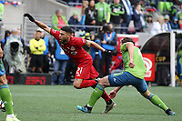 SEATTLE, WA - NOVEMBER 10: Jonathan Osorio #21 of Toronto FC is fouled by Gustav Svensson #4 of the Seattle Sounders FC during a game between Toronto FC and Seattle Sounders FC at CenturyLink Field on November 10, 2019 in Seattle, Washington.