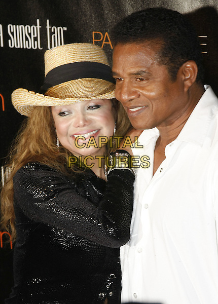 JACKIE JACKSON & LA TOYA JACKSON.Palms Place Hotel and Spa Grand Opening, Las Vegas, Nevada, USA, .31 May 2008..half length black shirt hat shiny plastic surgery white shirt brother sister.CAP/ADM/MJT.©MJT/Admedia/Capital Pictures