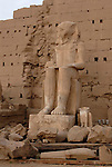 White Limestone Colossus in front of the Eighth Pylon.Karnak is part of the ancient city of Thebes ( built in and around modern day Luxor).The building of the Temple complex at Karnak began in the reign of the Pharaoh Senusret I who ruled Egypt from 1971-1926 BC. Approximately 30 Pharaohs contributed to the building of the complex and in so doing made it the largest ancient religious site in the world. The ancient name for Karnak was Ipet-isut (Most select of places).