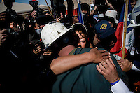 Relatives an memeber of the rescue team celebrate upon the news that the drilling machine already got to the tunnel were 33 miners are trapped since August 5th in San Jose mine in Copiapo, Chile..Rescue will begin in few hours, maybe days, they say.