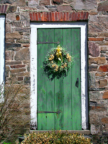 Old green door in old scottish rock house
