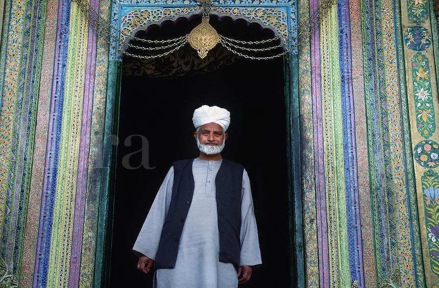 MUSLIM MAN stands at the entrance to SHAH HAMDAN MOSQUE near SRINIGAR - KASHMIR, INDIA
