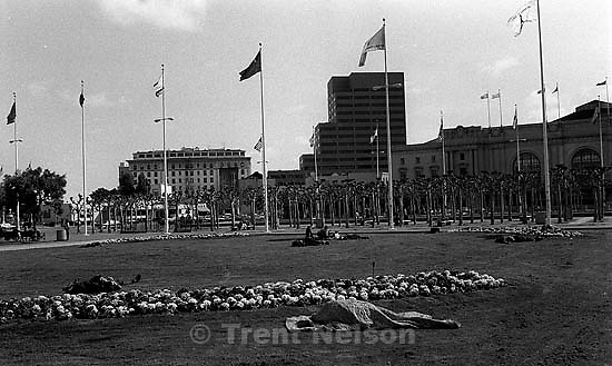 Bums sleeping on the grass in front of city hall.<br />