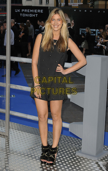 """FRANCESCA 'CHESKA' HULL.""""Real Steel"""" - UK film premiere held at the Empire Leicester Square - Arrivals..London, England..September 14th, 2011.full length sleeveless dress hand on hip black shoes open toe.CAP/CAN.©Can Nguyen/Capital Pictures."""