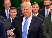 United States President Donald J. Trump answers questions from the media as he greets the 103rd Indianapolis 500 Champions: Team Penske, on the South Lawn of the White House in Washington, DC on Monday, June 10, 2019.  The President took some questions on trade, Mexico, and tariffs against China.<br /> CAP/MPI/RS<br /> ©RS/MPI/Capital Pictures