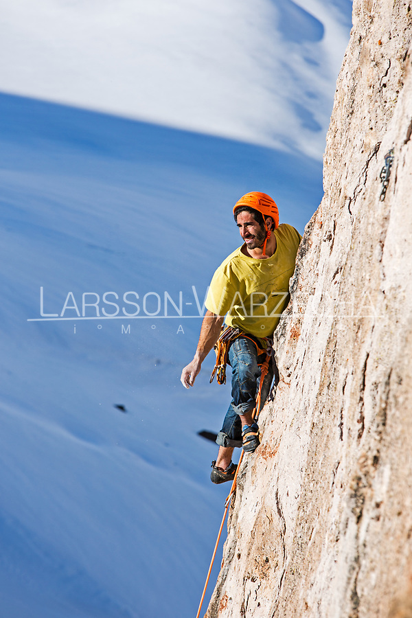 Lucho Birkner climbs some delicate and broken rock at one of the Los Monjes Blancos towers; Valle des los Condores.