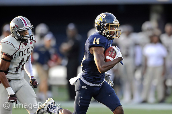 19 September 2015:  FIU wide receiver/kick return specialist Dennis Turner (14) takes a reception 64 yards for a touchdown in the first quarter as the FIU Golden Panthers faced the North Carolina Central University Eagles at FIU Stadium in Miami, Florida.