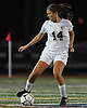 Selena Fortich #14 of North Shore moves the ball near midfield during the Nassau County varsity girls soccer Class A final against Manhasset at Cold Spring Harbor High School on Friday, Nov. 3, 2017. North Shore won by a score of 4-2.