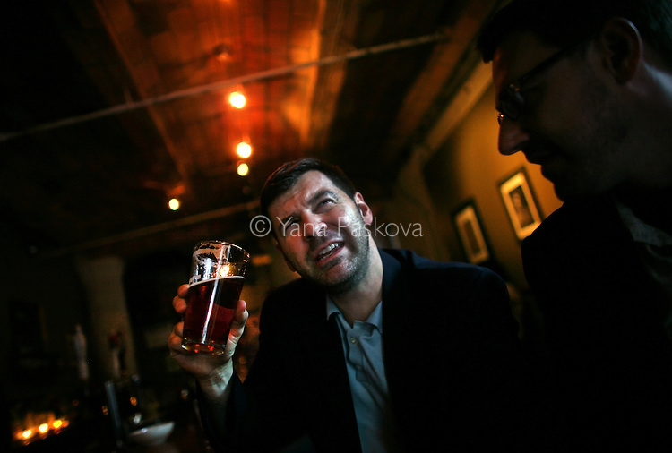 (L-R) Chris Hondros at 68 Jay St. Bar in Brooklyn, New York, in conversation with Todd Heisler, May 13, 2010...© Yana Paskova 2011