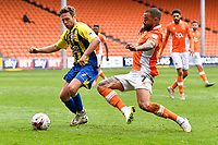 Accrington Stanley's Jordan Clark is tackled by Blackpool's Kyle Vassell<br /> <br /> Photographer Terry Donnelly/CameraSport<br /> <br /> The EFL Sky Bet League Two - Blackpool v Accrington Stanley - Friday 14th April 2017 - Bloomfield Road - Blackpool<br /> <br /> World Copyright &copy; 2017 CameraSport. All rights reserved. 43 Linden Ave. Countesthorpe. Leicester. England. LE8 5PG - Tel: +44 (0) 116 277 4147 - admin@camerasport.com - www.camerasport.com