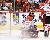 Dustin Tokarski (Canada - 30), Rudolf Cerveny (Czech Republic - 21), Keith Aulie (Canada - 32) - Team Canada defeated the Czech Republic 8-1 on the evening of Friday, December 26, 2008, at Scotiabank Place in Kanata (Ottawa), Ontario during the 2009 World Juniors U20 Championship.