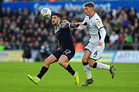 Alex Mowatt of Barnsley vies for possession with Jay Fulton of Swansea City during the Sky Bet Championship match between Swansea City and Barnsley at the Liberty Stadium in Swansea, Wales, UK. Sunday 29 December 2019