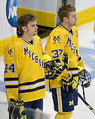 Jon Merrill (Michigan - 24), Mac Bennett (Michigan - 37) - The University of Minnesota-Duluth Bulldogs defeated the University of Michigan Wolverines 3-2 (OT) to win the 2011 D1 National Championship on Saturday, April 9, 2011, at the Xcel Energy Center in St. Paul, Minnesota.