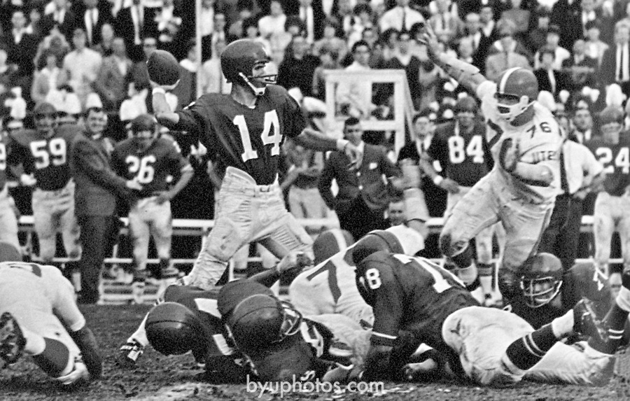 1965 vs. Utah-Carter_Banyan_p186<br /> <br /> 14 Virgil Carter quarterback going back to throw.<br /> <br /> Courtesy of L. Tom Perry Special Collections