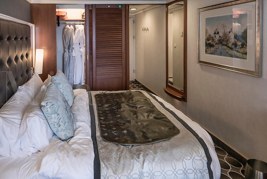 Luxury cruise ship cabin with double bed.
