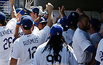 LOS ANGELES, CA. - September 19: Ronnie Belliard hits a Grand Slam Home Run during the game between the Los Angeles Dodgers and the San Fransisco Giants at the Dodger Stadium on September 19, 2009 in Los Angeles, California.