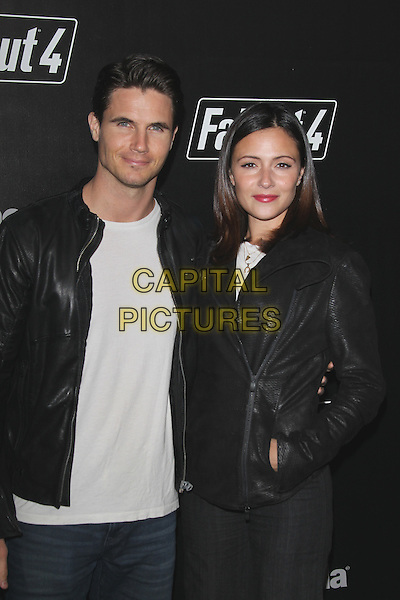 LOS ANGELES, CA - NOVEMBER 5: Robbie Amell and Italia Ricci at the Fallout 4 video game launch event in downtown Los Angeles on November 5, 2015 in Los Angeles, California. <br /> CAP/MPI21<br /> &copy;MPI21/Capital Pictures